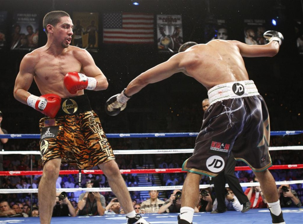 wbc_champion_danny_garcia_looks_on_as_amir_khan_of_50024d0472